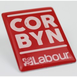 Picture of pin bdage with CORBYN labour slogan